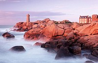 Granite coastline and lighthouse of Pors Kamor. Brittany, France