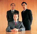 Portrait of Three Business Executives By a Table