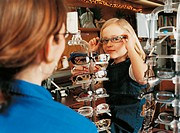 Portrait of a Young Girl Trying on a Pair of Glasses in An Opticians