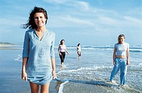 Portrait of Four Young Women Standing on a Beach