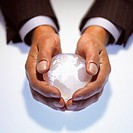 Close up of a Businessman Holding a Globe in His Hands