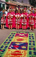Typical carpet and Mayan indians dressed as Roman soldiers during the Holy Week. Antigua Guatemala. Guatemala