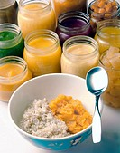 Field of jars with rice cereal and mashed sweet potatos