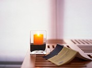Candle and open book on table