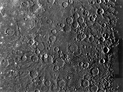 Mariner 10 photograph of the surface of Mercury, the innermost planet, showing a region of typical, heavily-cratered terrain. The small, white-floored...