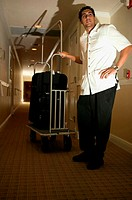 Hotel porter in corridor