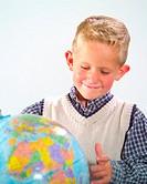 Boy Discovering Globe