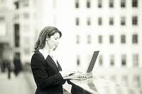 Businesswoman Working on Rooftop