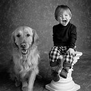 expressive child with Golden Retriever