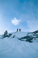 Skiers On Snowy Ridge
