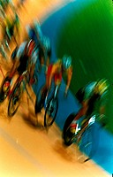 Blurred effect of cyclists in velodrome