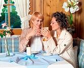 Women having afterlunch coffee