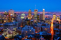 Nighttime view of downtown Montreal skyline and South Shore from atop Mount Royal (Mont Royal) in winter. Quebec, Canada