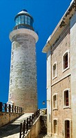 Lighthouse at Castillo de los Tres Reyes del Morro in the Parque Historico Militar Morro Cabana, located across the bay from Havana.  The El Morro for...