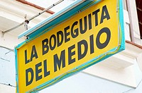 Sign for 'La Bodeguita del Medio', a bar in Old Havana (Habana Vieja) popularized by Ernest Hemingway. Havana, Cuba