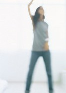 Silhouette of young woman, blurred