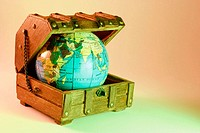 World globe in wooden treasure box