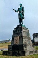 Statue of Christian the ninth of Danmark standing in front of the Goverment Offices in Reykjavik, Arnarholl in the background