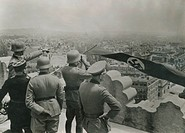 Soldiers look over city from a height