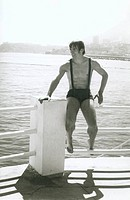 Ballet dancer Rudolf Nurejev sitting on a railing