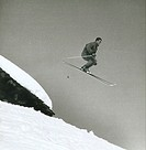 Tony Sailer flies through the air on skis
