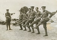 An officer points to a line of solders with legs raised