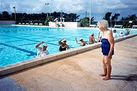 Senior citizens in the swimmingpool making gymnastics.Florida,USA.