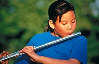 Asian girl playing flute