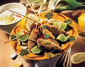 skewers of chicken with lemon and lime