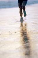 35 years old woman running on beach. California. USA.