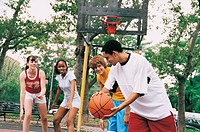 Teenage Girls and Boys Playing Basketball