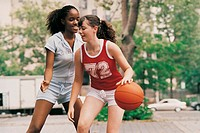 Teenage Girls Playing Basketball