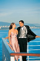Romantic Newlywed Couple Leaning on Railings on a Cruise Ship