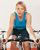 Young Woman Works-Out on an Exercise Bike