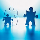 Three Jigsaw Pieces Representing Parents and a Child
