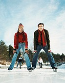 Portrait of Two Young Adults Standing on Ice