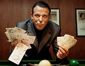 Greedy Gambling Businessman Holding Banknotes