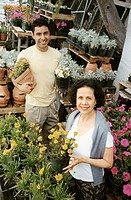 Mother and Son Shopping for Plants Together