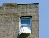 Beautiful fa&#231;ade of a building. Window with a drape. Hoboken, New Jersey. USA
