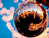 Reflection of a tavern on the Green in a giant Christmas ball. New York city, New York. USA