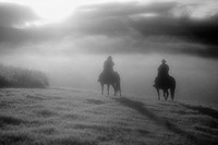 Silhouette of cowboy & cowgirl, Douglas Lake Ranch, British Columbia, Canada´