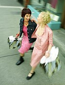 Two women shopping on Robson St., Vancouver, B.C.