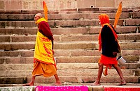 Two Hindu religious men walking along the ghat in Varanasi, India