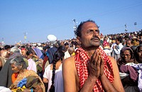Hindu man pray. Kumbh Mela festival. Allahabad, India