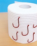 New plain white roll of toilet paper with red fish hooks on the roll