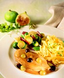 Chicken breast with grape sauce and ribbon pasta