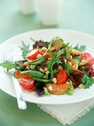 Colourful salad with roasted sweet potatoes & macadamia nuts
