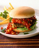 Chili burger with pepper sauce and chips
