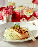 Salmon fillet with potato whip on romantic table for two