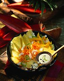 Spicy pineapple and mango salad with coconut